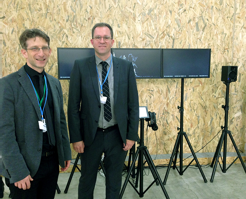 Roman Zweifel and Marcus Maeder in front of the installation